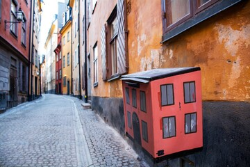 Canvas Prints Narrow alley Cute mailbox in a narrow alley with colorful buildings