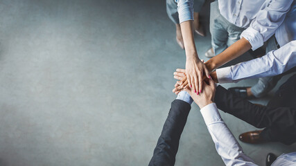 Group Of Business People Holding Hands In Office, Cropped, Top-View