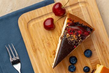 Vanilla cheesecake with chocolate top and berries
