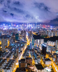 Wall Mural - Aerial view of the Victoria Harbour, Hong Kong, night time. famous travel destination.