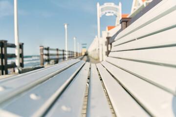 White bench on the boardwalk. Baltic Sea. The beach of Zelenogradsk. Kaliningrad region. High quality photo