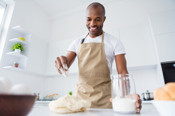 Portrait of his he nice attractive confident cheerful guy confectioner preparing fresh bread pizza...