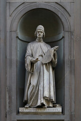 Statue of Leon Battista Alberti, outdoor the Uffizi museums, Florence, Italy, famous touristic place
