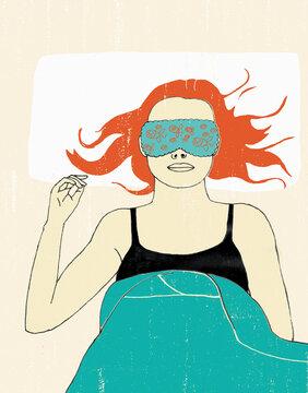 Woman in bed wearing sleep mask