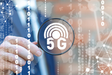 Businessman using magnifier is looking and analysing 5g technology. 5g Connection Network Web Mobile Technology. Fifth Next Generation Modern Communication Concept.