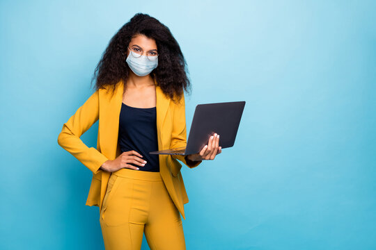 Photo of her she attractive chic classy lady using laptop wearing safety mask mers cov infection preventive measures working remotely from home wfh isolated blue color background