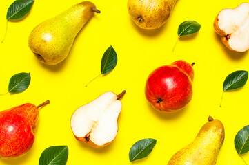 Wall Mural - Creative background with pears and green leaves. Pattern of Juicy ripe fresh green and red pears on yellow background flat lay top view copy space. Fruit background, organic healthy food. Harvest