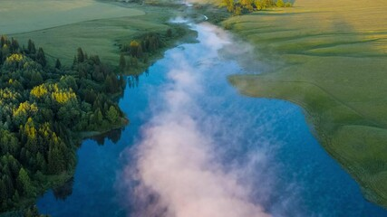 Wall Mural - Fog on lake timelapse. Aerial timelapse of the lake with morning fog forming over the water surface during sunrise