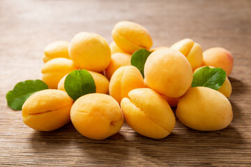 fresh ripe apricots on a wooden table