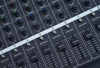 Top view shot at the faders of a vintage analog, studio music mixer