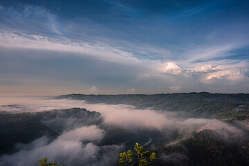 Cloudy blue sky background in foggy misty valley in Java Island, Indonesia