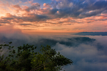 Beautiful landscape in golden hours sunrise sky above the foggy forest and hills