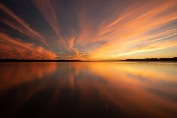 Keuken foto achterwand Bruin Colorful Golden and Orange Sunset Sky Over River With Reflections in the Calm Water