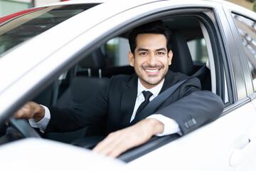 Smiling Businessman Driving Car