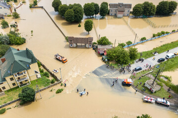 Aerial view of flooded houses and rescue vehicles saving people in Halych town, western Ukraine.