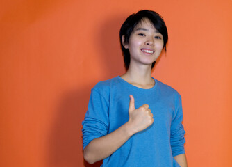 Positive chinese young adult man with blue shirt