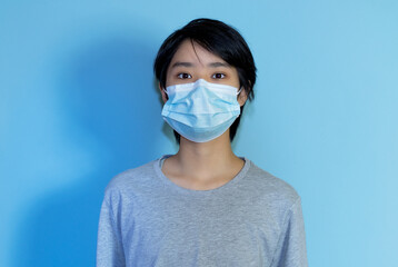 Asian young adult man wearing protection mask to prevent getting sick