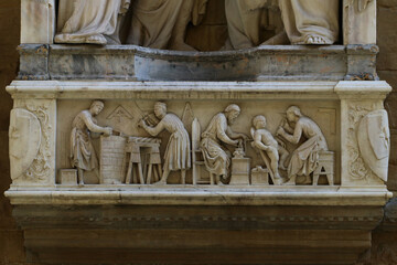 Masters of wood and stone workers bas-relief detail, Orsanmichele church, Florence, Italy, touristic place