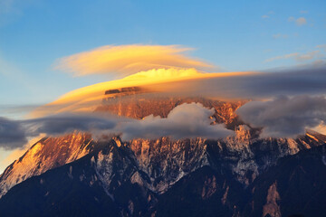 Close up of Mount Kinabalu with lenticular clouds during sunset in Kinabalu National Park, Sabah...