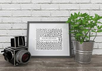 Photo Art Horizontal Frame Mockup with Camera and Flower