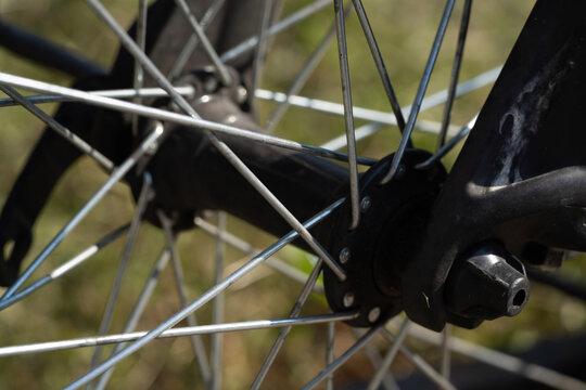 bicycle wheel spokes metal knitting, lifestyle photo