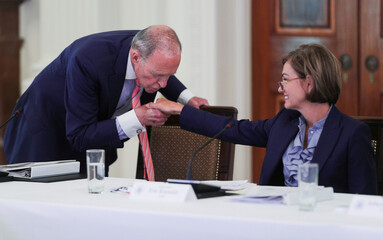 White House economic advisor Kudlow kisses Iowa Governor Reynolds hand in Workforce Policy Advisory Board meeting at the White House in Washington