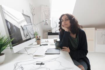 Woman at desk in artist's studio