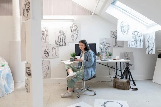 Artist using phone in studio