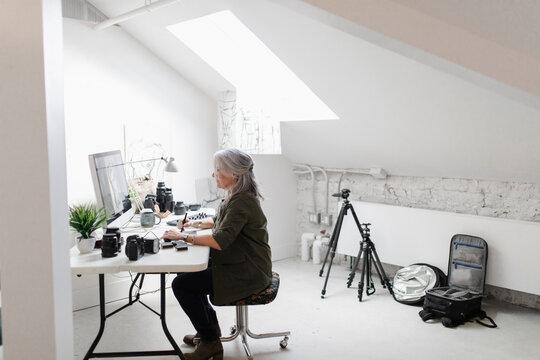 Woman working at desk in creative studio