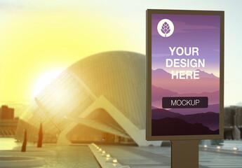 Billboard Advertising Kiosk with Modern Bulding Mockup