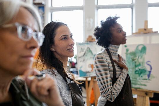 Women listening in art class