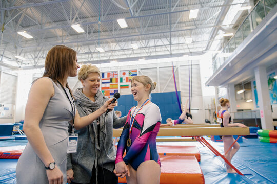 News reporter interviewing gymnast and mother