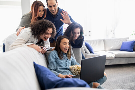Family on video call on computer