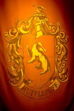 MADRID, SPAIN - NOV 22, 2017: Hufflepuff, symbol, Wizarding world of Harry Poter experience in Madrid, Spain