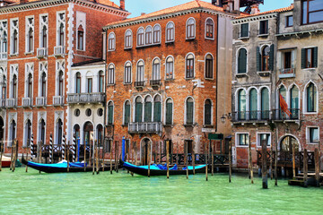 Wall Murals Gondolas Houses with moored gondolas along Grand Canal in Venice, Italy