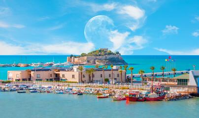"Pigeon Island with a ""Pirate castle"". Kusadasi harbor with full moon - Aegean coast of Turkey."