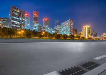 Fotomurales - Asphalt highway and modern business district office buildings in Beijing at night, China