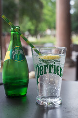 Mulhouse - France - 26 June 2020 - Closeup of Perrier glass of carbonated mineral water on terrace restaurant