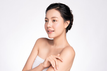 Beautiful Young Asian Woman touching her body with fresh Healthy Skin, isolated on white background, Beauty Cosmetics and Facial treatment Concept.