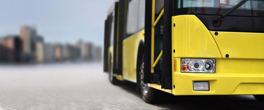 City bus on background city skyline
