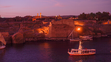 Printed roller blinds Bordeaux Nile river at sunset evening beautiful sky with ruin wall and lighting with felluca boat crusing