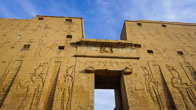 Entrance of Edfu temple of Horus majestic beautiful landmark with ancient blue paint on wall