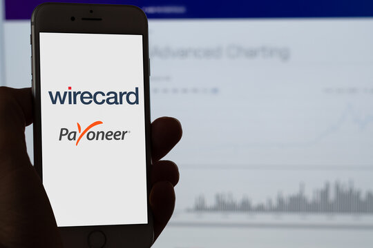 Guilherand-Granges, France - June 27, 2020. Smartphone with wirecard and Payoneer logo. Wirecard is a payment processor and financial services provider.