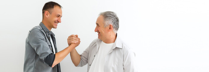 Senior Father With Adult Son on a white background