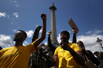 "People gather during a demonstration called ""Justice for Shukri Abdi"" in London"