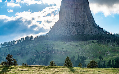 Fototapete - Devils Tower in natural landscape at sunset, Wyoming, United States