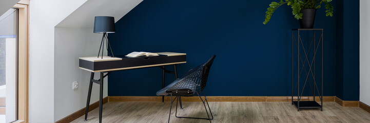 Study room with navy blue wall, panorama