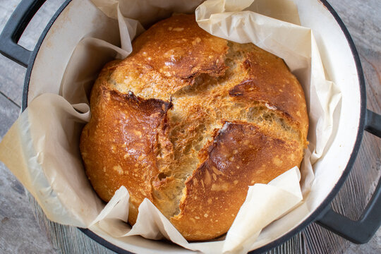 whole sourdough bread loaf with nice crust peaks in dutch oven
