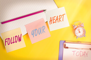 Handwriting text writing Follow Your Heart. Conceptual photo Motivation to do what is right and fulfill your desire Flat lay above table with blank papers with copy space for text messages
