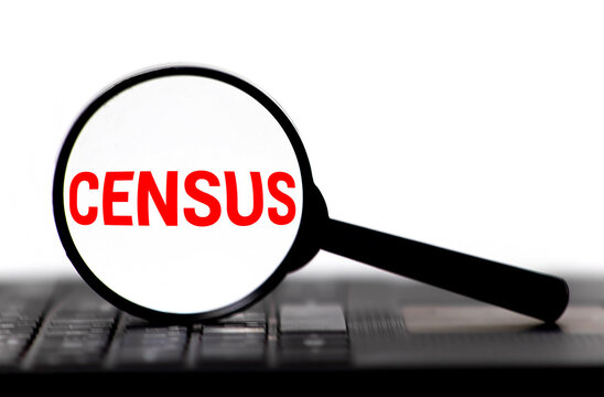 Census word on memo note throught the loupe magnifier